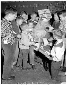 Children at Boysville visiting with Santa, 1952. (SCElicson.08.005)