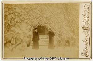Twin sisters Florence and Blanche Riddge pose in front of their home during a snow storm on February 14, 1895. Florence Riddle (1867-1969) served as custodian of the Alamo for the Daughters of the Republic of Texas.