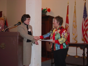 Former DRT Library director Elaine Davis presents a certificate to Award winner Debra Winegarten.