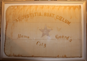 The flag of the Alamo City Guards. Donated by Mrs. O. M. Burt; restoration assisted by the Sons of Confederate Veterans. Image courtesy of Ernesto Rodriguez, Alamo assistant curator.