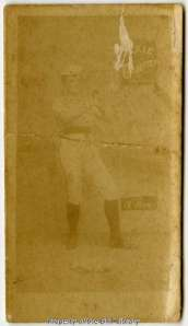 Female baseball player, playing at third base.