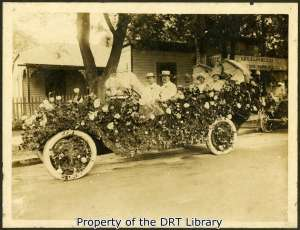A car decorated with flowers, circa 1910-1920.