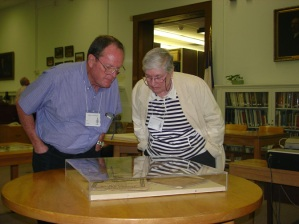 Members of the Texas Map Society examining some of the materials on display.