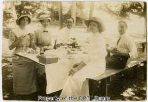 Five friends enjoying a picnic. (SC09.013)