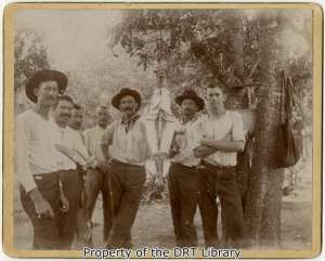 Fishermen displaying the day's catch - a large catfish. (SC09.014)
