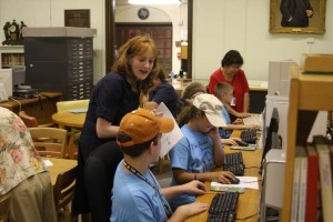 Archivist Caitlin Donnelly and library assistant Lydia Cuellar assist campers in searching online census records.