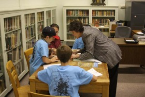 Cataloging librarian Beverly Ewald helps students use library materials to conduct research.