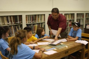 Library Assistant Rusty Gamez showed campers reproductions of artwork by Theodore Gentilz.