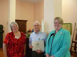 From left to right, Elaine Milam Vetter, DRT Library Committee Chairman; Donald Raney; Leslie Stapleton, DRT Library Director.