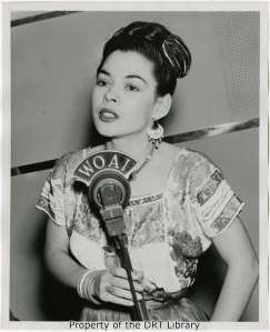 "The Elicson collection contains several images of Rosita Fernandez Almaguer singing at WOAI studios. She was a beloved singer who was known as San Antonio's ""first lady of song"" and ""favorite rose."""