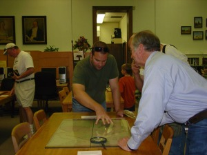 "Visitors looking at the library's copy of ""Genl. Austin's Map of Texas with Parts of Adjoining States,"" published by Henry Schenck Tanner in 1840."