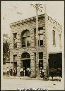 John C. Dielmann's store at 306 E Commerce Street, April 27, 1907. From left to right are Leo M. J. Dielmann, his brother William V. Dielmann, Henry Burns, John J. Jehl, John C. Dielmann, the bookkeeper, and George Theis.