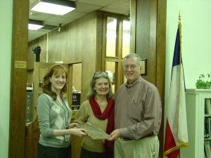 Archivist Caitlin Donnelly with donors David and Myrna Langford.