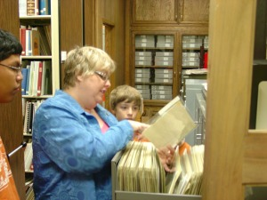 DRT Library Director Leslie Stapleton shows students one of the nearly 40,000 photographic images in the Library's collections.