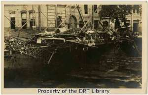 A damaged downtown bridge with debris.