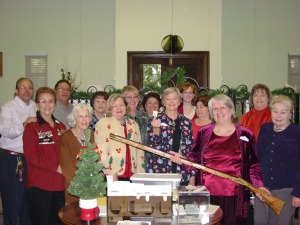 DRT Library staff and committee members pose with the replica Dickert rifle during this morning's drawing.