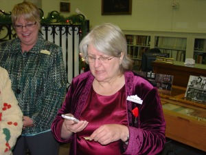 DRT Library Committee Chairman Elaine Milam Vetter called Jackie Henry to tell her she had won the raffle.