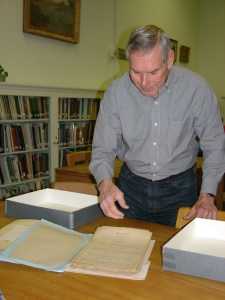 "Lee Howard presents a manuscript draft of A.J. Sowell's ""Life of Big Foot Wallace"" to the DRT Library."