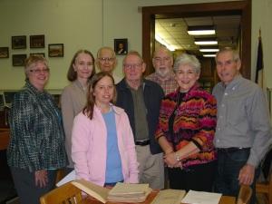 From left to right, DRT Library Director Leslie Stapleton, Sarah Westkaemper Lake, John Westkaemper, Amy Howard Herpeche, Russell Howard, John Howard, and Dale and W. Lee Howard.