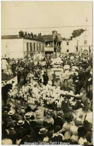Helena Guenther on her float in Alamo Plaza during the 1911 Battle of Flowers Parade.