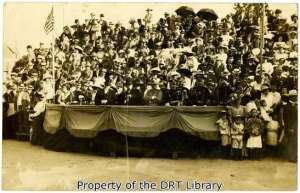 Spectators in an undated photograph, believed to show the 1911 Battle of Flowers Parade.