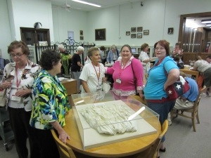 DRT members pose with Cataloging Librarian Beverly Ewald and the Angelina Dickinson petticoat.