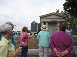 Sherri Driscoll, Alamo Museum Educator, with Forum participants in front of Clara Driscoll's tomb.
