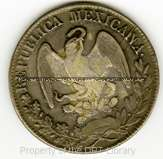 "This is an 1835 Mexican ""Freedom Cap"" coin for ocho (eight) reales. These would have been in circulation in Texas in the 1830s, primarily used to pay Mexican soldiers' wages. Santa Anna recovered a large trove of these coins from a regional mint in Mexico, and he shipped many of them north to pay for his Texas campaign. DRT 7, Mexican coin 1835."